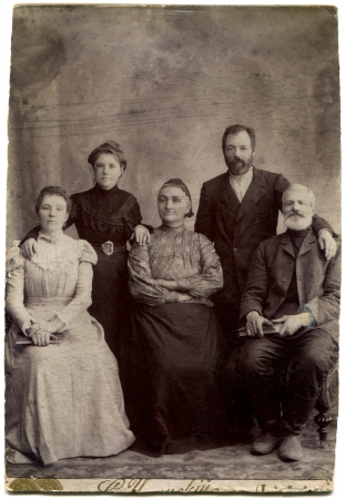 RUSSIA - CIRCA end of the XIX - the beginning of XX century  An antique photo shows family of five persons in two generations, Lugansk, Russian Empire, UkraineRussian text  Umanskiy  name of photographer , Lugansk