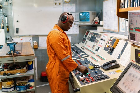 Photo pour Marine engineer officer working in engine room - image libre de droit