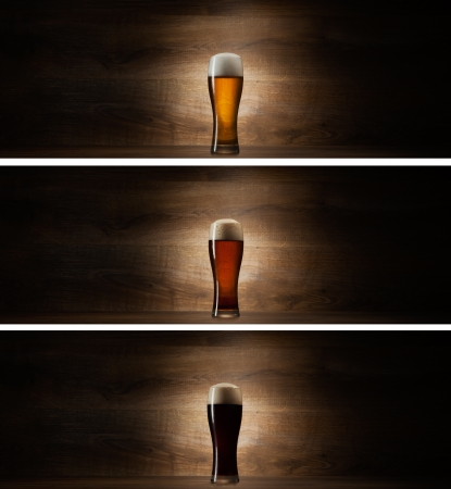 Foto de glass beer on wood background with copyspace - Imagen libre de derechos