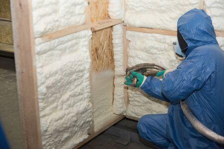 Foto de Workers insulate walls with special mounting foam - Imagen libre de derechos