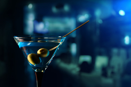 Photo for glass with martini , focus on a olives - Royalty Free Image