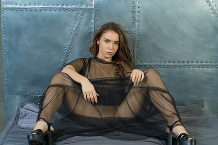 Foto de beautiful girl posing in a black transparent dress - Imagen libre de derechos