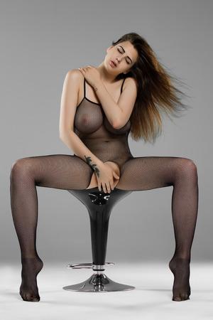 Foto de beautiful girl posing nude in black lingerie - Imagen libre de derechos