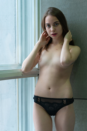 Foto per young beautiful girl posing in black lingerie - Immagine Royalty Free