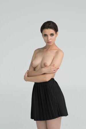 Foto per young beautiful girl posing nude in studio - Immagine Royalty Free