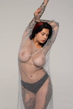 Foto de young beautiful girl pose in studio, stands in black transparent underwear - Imagen libre de derechos