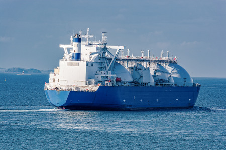 Photo for Liquefied natural gas (LNG) tanker is passing by Strait of Singapore. - Royalty Free Image