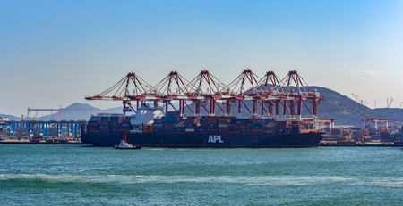 Photo for QINGDAO, CHINA - Jan 20, 2017: American President Lines (APL) container vessel APL DETROIT loading with dockside gantry cranes in Qingdao Qianwan Container Terminal. - Royalty Free Image
