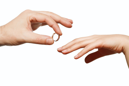 Photo pour male and female hand with a wedding ring - image libre de droit