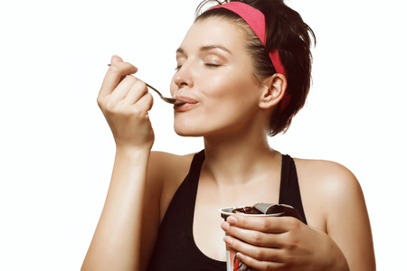 Photo for young and beautiful woman eating a delicious ice cream with chocolate - Royalty Free Image