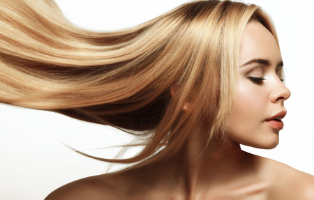 Photo pour portrait of a beautiful and young blonde with long groomed hair - image libre de droit