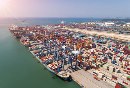 Photo for The busy of port congestion loading and discharging  containers services in maritime transports in World wide logistics  - Royalty Free Image