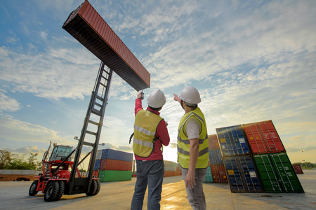 Photo for foreman and supervisor are working in container yard with forklift stacker handling the shipment - Royalty Free Image