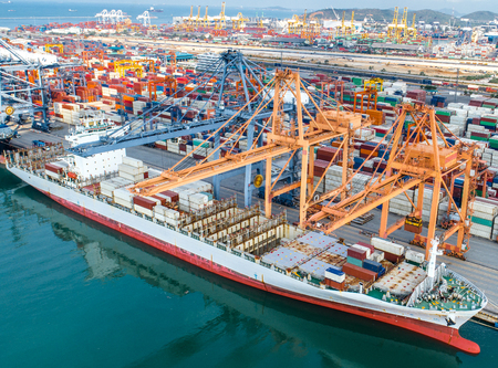 Photo for commercial ship vessel operation in port for transhipment the containers shipment, the logistics transport services to worldwide international - Royalty Free Image