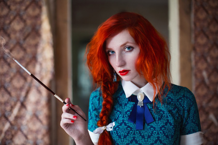 Photo pour long-haired red-haired girl with a mouthpiece in hand - image libre de droit