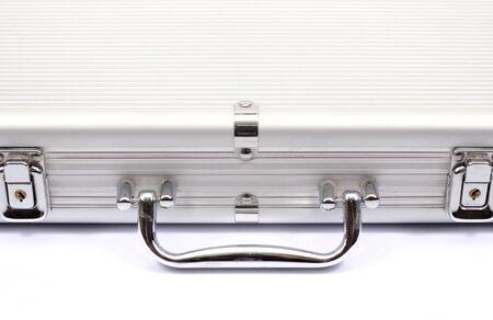 Foto de Metallic suitcase on white - Imagen libre de derechos