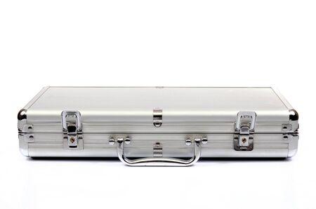 Foto de Metallic suitcase on white background, metalic briefcase - Imagen libre de derechos
