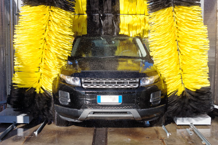 Automobile through a car wash machine