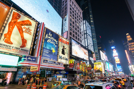 Foto für NEW YORK CITY - JUNE 12, 2015: Times Square at night featuring lighted billboards of the broadway best show - Lizenzfreies Bild