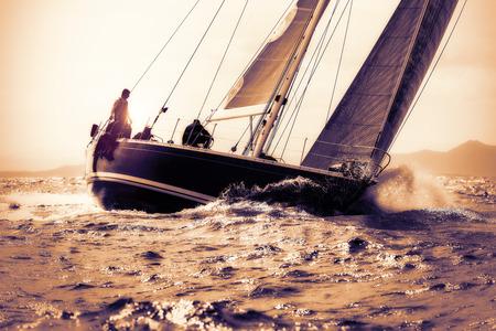 Photo pour sail boat sailing on sunset - image libre de droit