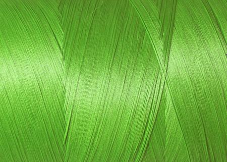 Foto de texture of blue synthetic thread in spool - Imagen libre de derechos