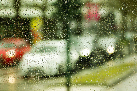 Rainy day on the street, view through the car window