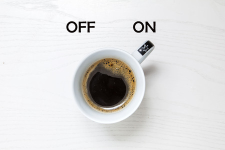 Photo for Cup of coffee on white desk, switched on, concept - Royalty Free Image