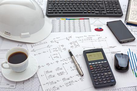 Foto de Desk of Civil Design Engineer who has just made structural analysis calculations using a scientific calculator. - Imagen libre de derechos