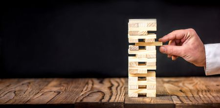 Photo for Taking Risk To Make Buiness Growth Concept With Wooden Blocks - Royalty Free Image