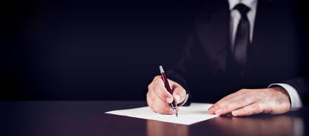 Photo pour Businessman Writing A Legal Letter - image libre de droit