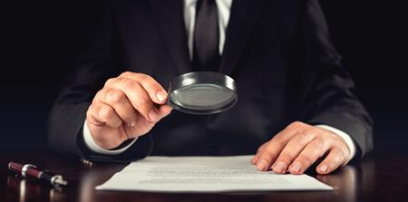 Foto de Businessman Reading Contract Details Before Signing - Imagen libre de derechos