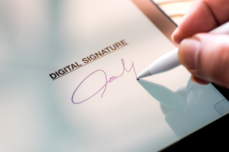 Foto de Digital Signature Concept with Tablet and Stylus Pen - Imagen libre de derechos