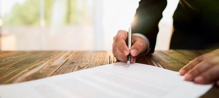 Photo pour Businessman Signing An Official Document - image libre de droit