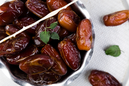 Photo for Dry fruit dates on silver tray. Copy space. Top view - Royalty Free Image
