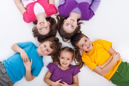 Photo for Five happy kids on the floor laying in circle - Royalty Free Image