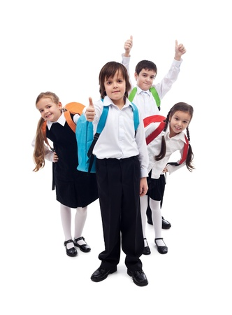 Photo for Group of happy kids with backpacks returning to school after summer vacation - Royalty Free Image