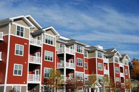 Foto de Close up on modern apartment building with blue sky - Imagen libre de derechos