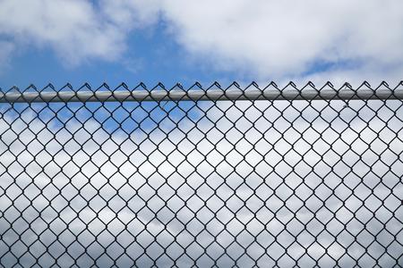 Photo pour iron chain link fence against sky - image libre de droit