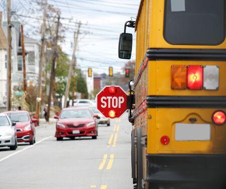 Photo pour school bus with stop sign flashing on the street - image libre de droit