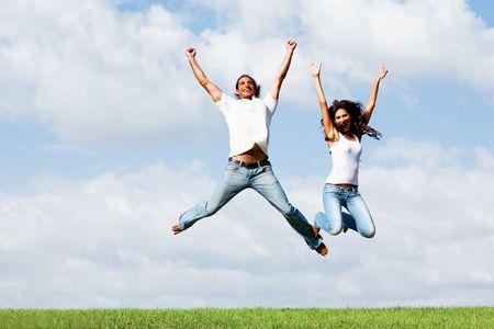 Jumping joyful couple