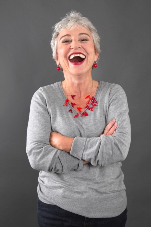 Foto per Smiling elderly lady in gray - Immagine Royalty Free