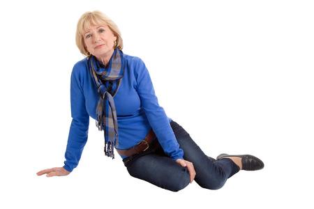 Foto für Happy senior woman sitting on floor isolated on white  - Lizenzfreies Bild