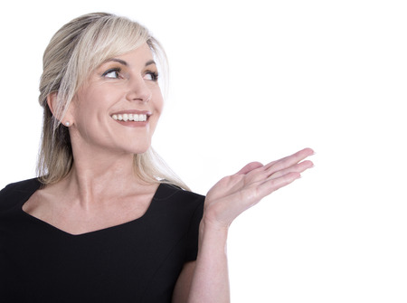 Foto per Face of a beautiful older woman looking sideways and presenting with her hand. - Immagine Royalty Free