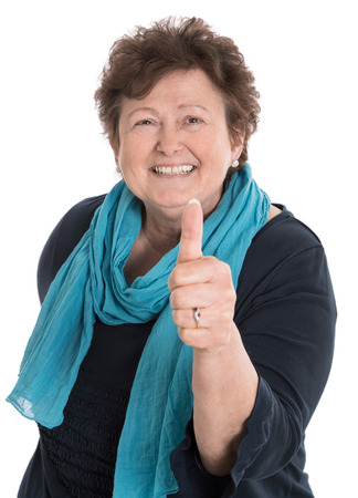 Foto für Isolated happy older woman with thumb up and blue shirt. - Lizenzfreies Bild