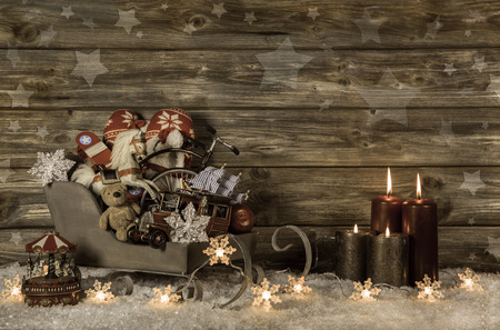 Photo pour Old children toys and four red burning advent candles on wooden vintage background for decoration. - image libre de droit