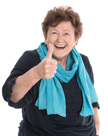 Foto per Happy isolated older lady wearing blue clothes with thumb up gesture over white background. - Immagine Royalty Free