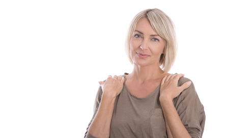 Beautiful isolated blond smiling mature woman over white background.
