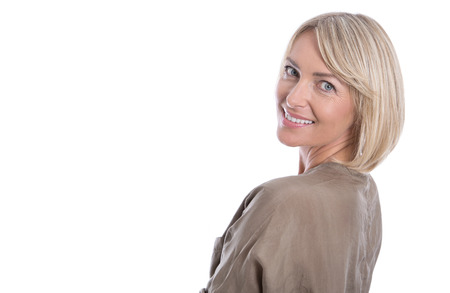 Foto per Beautiful isolated blond smiling mature woman over white background. - Immagine Royalty Free