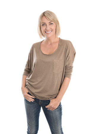 Happy middle aged blond woman in blue jeans isolated over white.