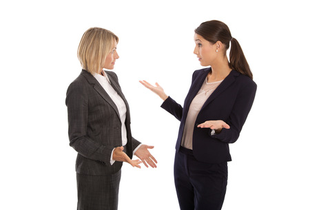 Foto de Two isolated business woman talking together. - Imagen libre de derechos